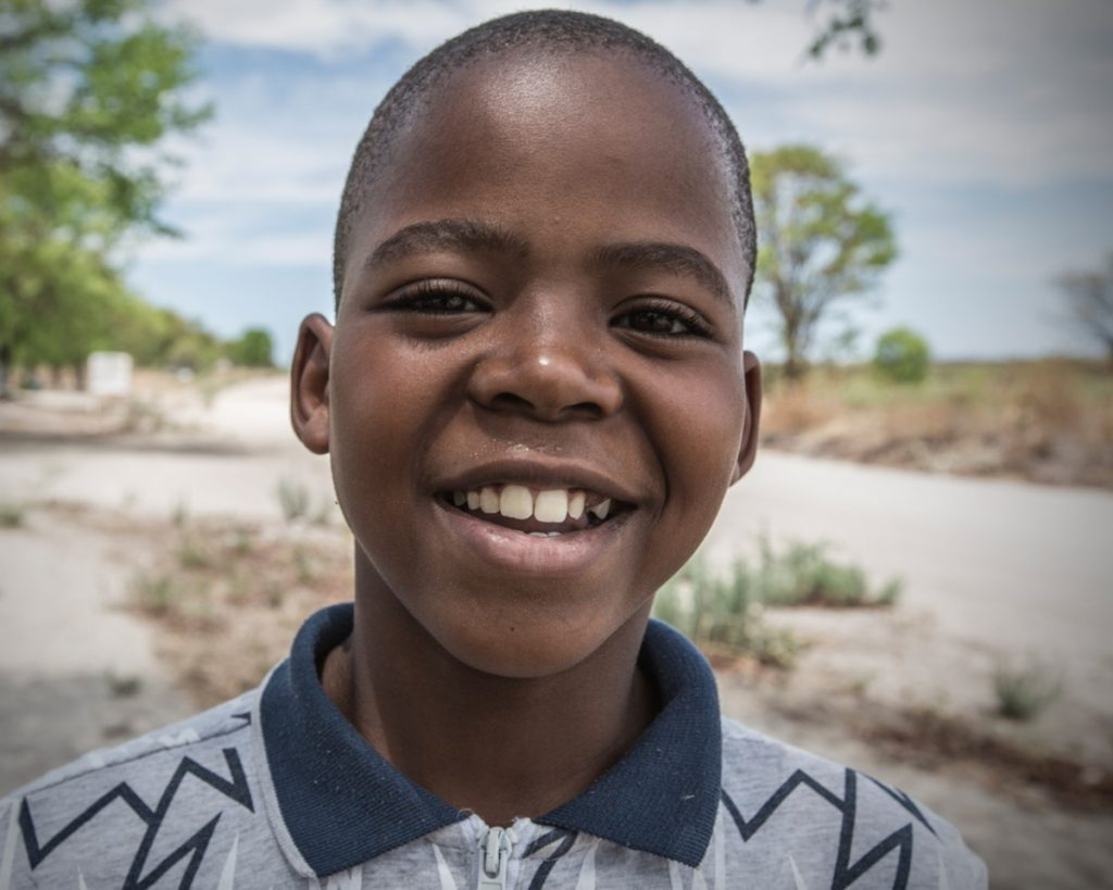 Young boy smiles in Sankuyo village