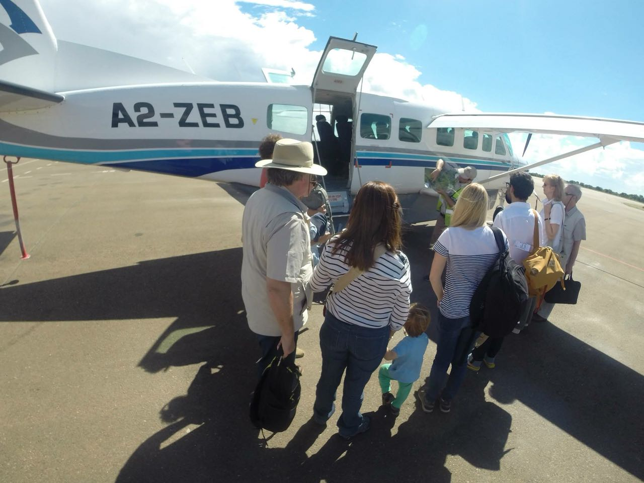 Family safari getting on board a cessna caravan in Maun, Botswana