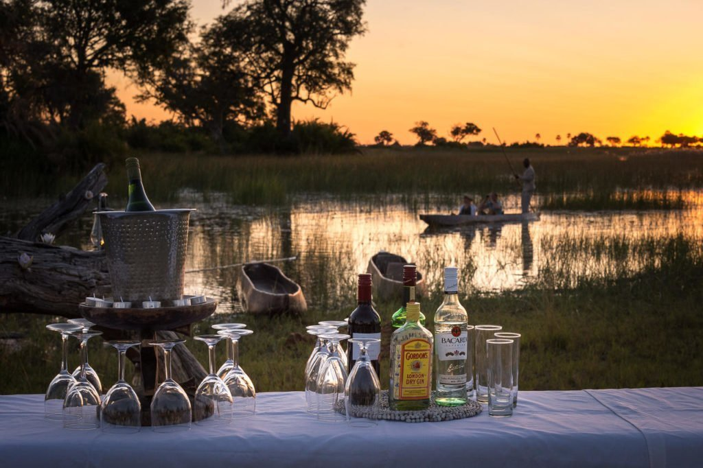 Sundowners on a mokoro at in the Okavango Delta