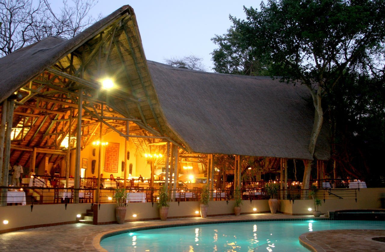 Pool and dining area at the Chobe Safari Lodge